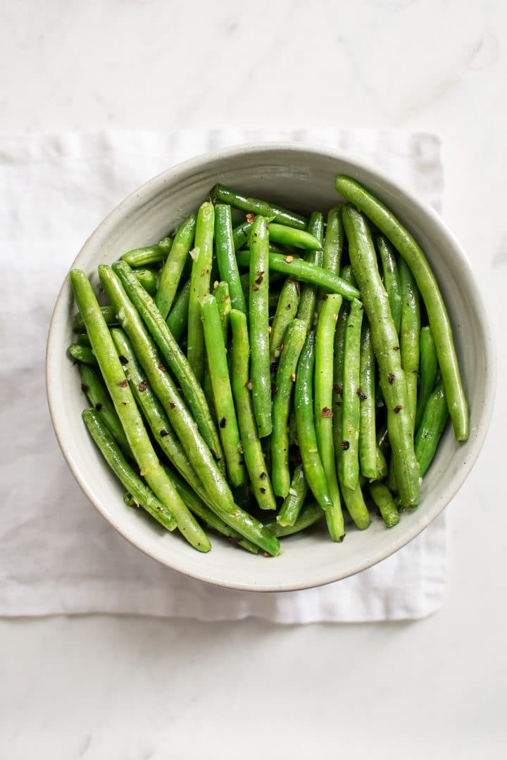 These healthychili garlic green beans are boiled then sautéed to perfection in one pan. They couldn't be easier or more delicious! You'll love the garlic butter in this easy stove top recipe.