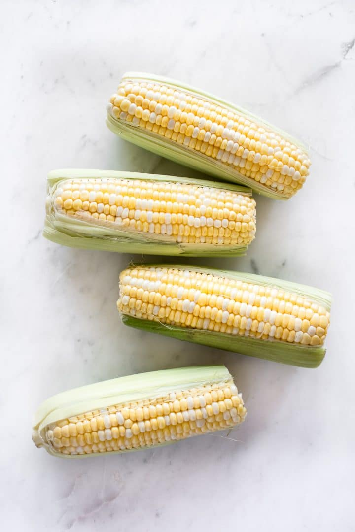 It's fast and easy to cook corn on the cob in your Instant Pot! You will love this method for cooking perfect corn every time. This healthy summer side dish recipe is perfect for BBQs or potlucks.