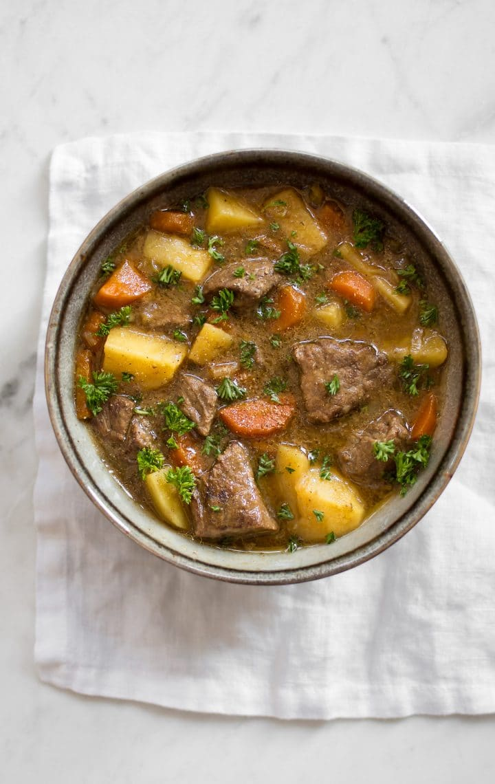 This Instant Pot Irish stew has tender beef, potatoes, carrots, and a delicious traditional Guinness sauce. You will love this simple stew recipe! It's perfect for St. Patrick's Day or any occasion where you want a comforting beef stew recipe. The electric pressure cooker makes this authentic recipe so easy to make.