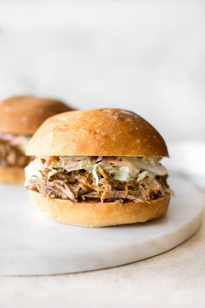 With this easy Instant Pot pulled pork recipe, you can get that slow-cooked taste - fast! This recipe uses pork shoulder, a delicious dry rub, and liquid smoke for the best tender, juicy, and fall apart pulled pork. This electric pressure cooker pulled pork makes an awesome simple family meal.