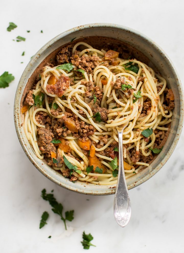 This healthy, quick, and hearty Instant Pot spaghetti sauce recipe makes a big batch perfect for freezing! This homemade tomato and meat sauce for pasta is sure to become a family favorite. A simple recipe from scratch.