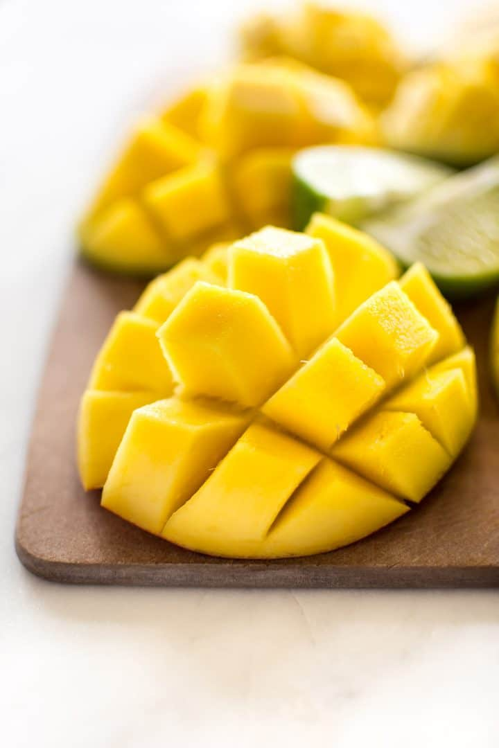 diced mango on a wooden cutting board