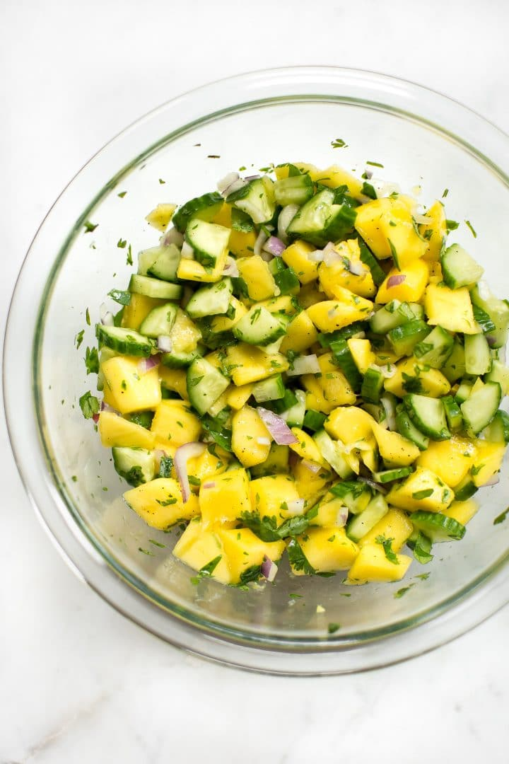 glass mixing bowl with healthy mango vegan salsa