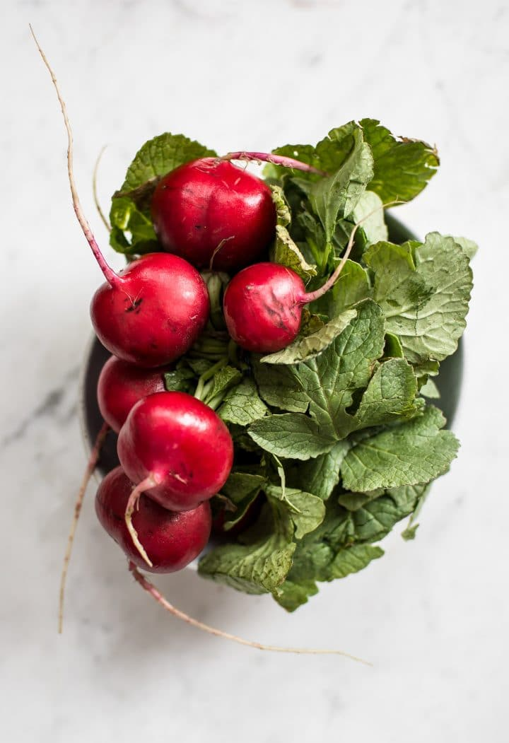 This roasted radishes recipe is low-carb, keto, and vegan. Super easy and healthy!