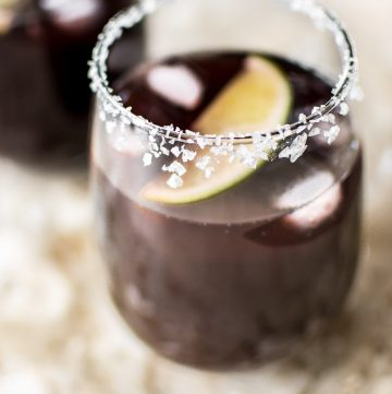 This easy black cherry margarita on the rocks recipe is the perfect refreshing summer drink for girls' night, parties, or backyard BBQs. A Cinco de Mayo favorite!