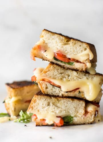 This gourmet Caprese grilled cheese sandwich is made with mayo instead of butter to get an ultra-crispy crust! This vegetarian recipe is quick, simple, and tasty comfort food. A healthier take on grilled cheese with tomatoes, basil, and fresh mozzarella.