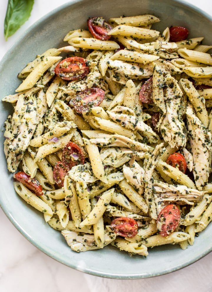 This healthy cold pesto pasta salad with chicken is simple to make and bursting with the fresh taste of basil and tomatoes.