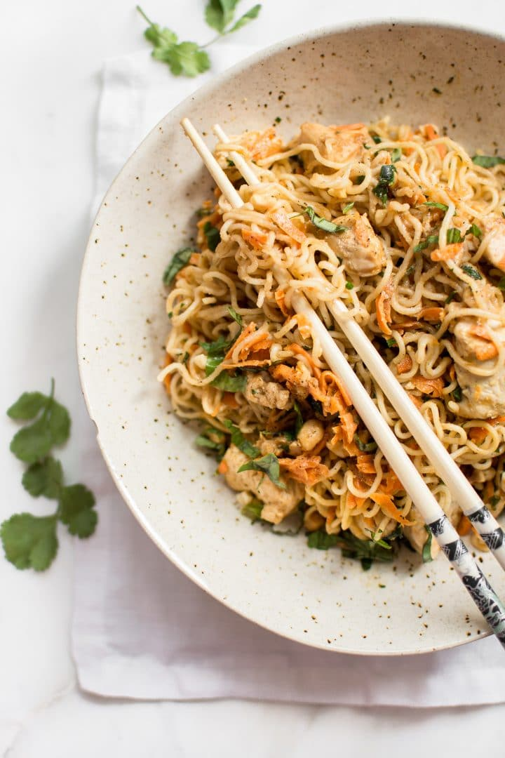 This easy ramen stir fry recipe with chicken is a simple weeknight dinner that's perfect for busy families. Peanut butter, sriracha, soy sauce, lime, garlic, carrots, cilantro, basil, and green onions make this one flavorful dish!