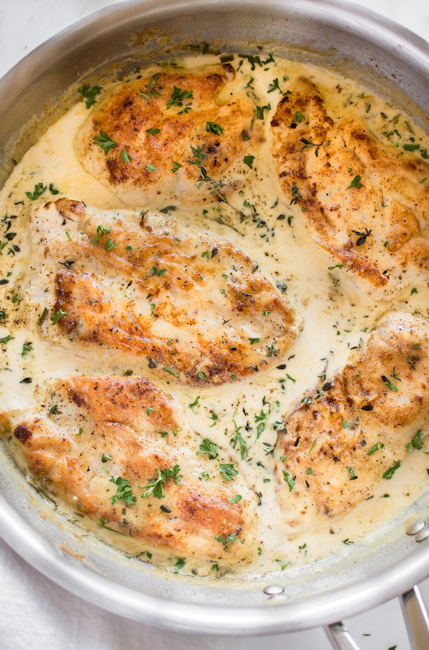 Tender chicken breasts smothered in a creamy herb sauce makes a simple and delicious comfort food dinner. Creamy herb chicken is great served over potatoes or pasta!