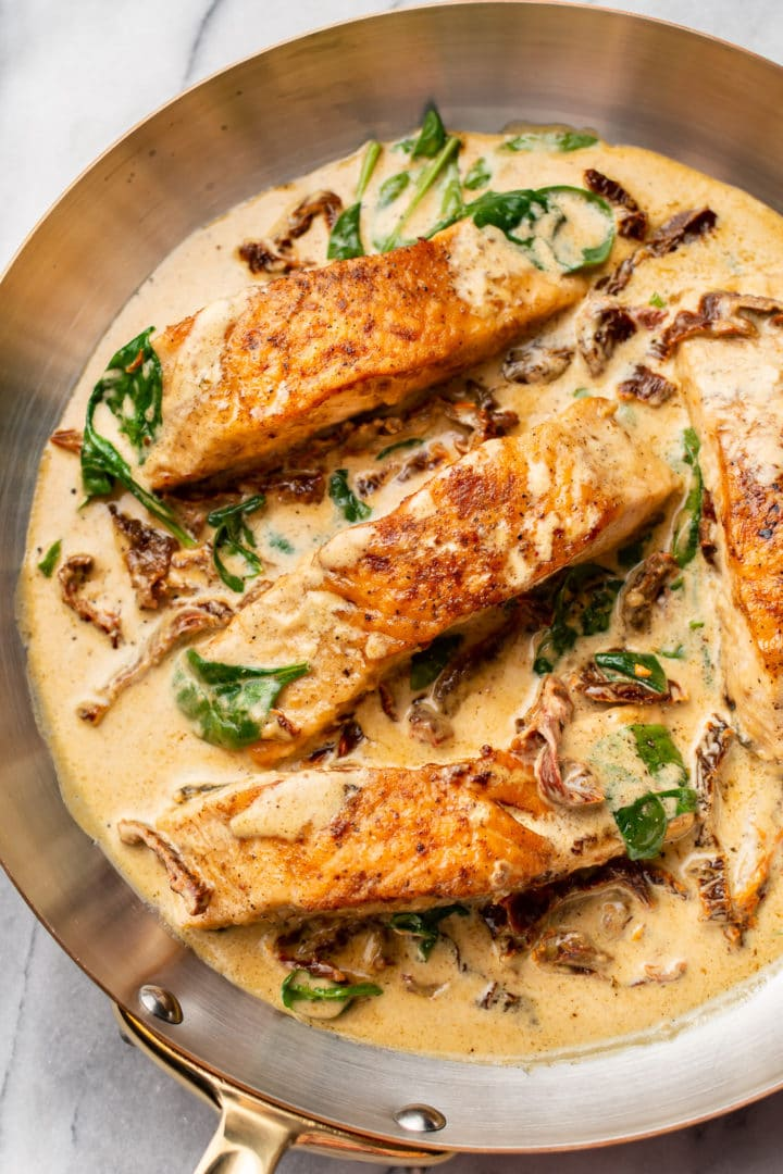 close-up of creamy Tuscan salmon in a skillet