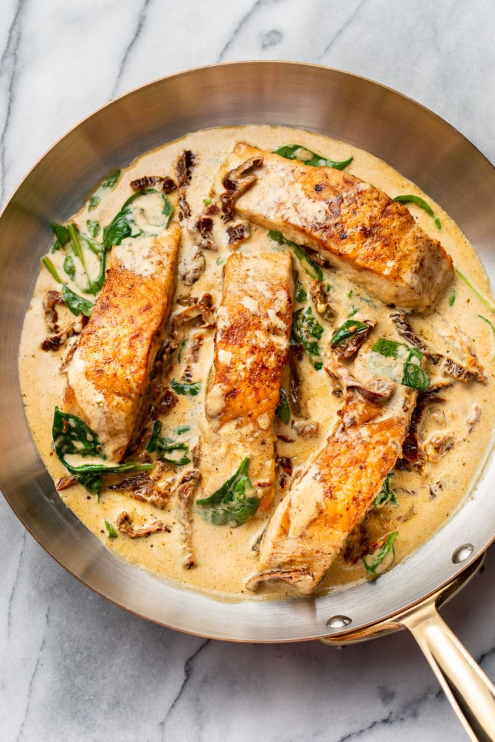 creamy Tuscan butter salmon in a skillet