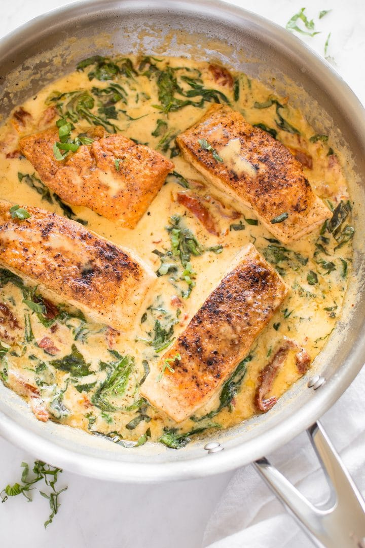 Creamy Tuscan salmon is a 20-minute family-friendly pan seared salmon dinner recipe with the most delicious sun-dried tomato, spinach, garlic, and lemon sauce. It's great served over pasta, rice, or mashed potatoes.