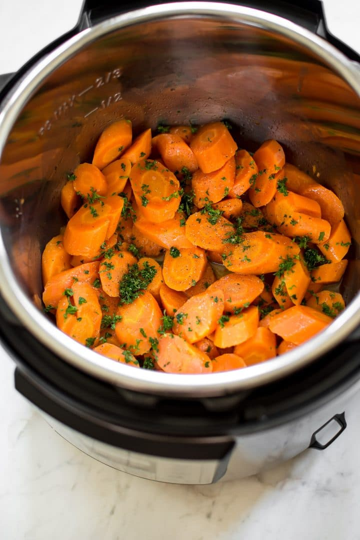 These honey butter steamed Instant Pot carrots are quick and healthy. The perfect easy electric pressure cooker side dish. Great for weeknight family meals or special occasions like Thanksgiving or Christmas dinner.