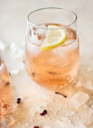 This easy, low-calorie rosé wine spritzer recipe makes the best summer drink. This blush skinny drink is made with sparkling club soda. It's perfect for girls' night or party!