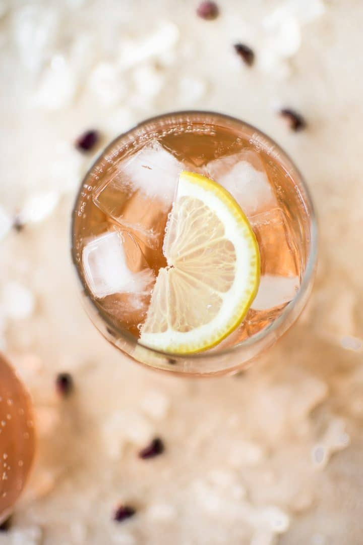This easy, low-calorie rosé wine spritzer recipe makes the best summer drink. This blush skinny drink is made with sparkling club soda. It's perfect for girls' night!