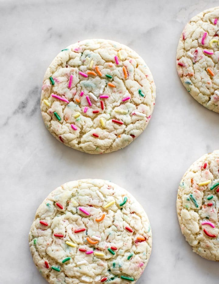These soft funfetti cookies are made from cake mix, so they're super easy and fast. These are the best simple chewy rainbow sprinkle cookies!