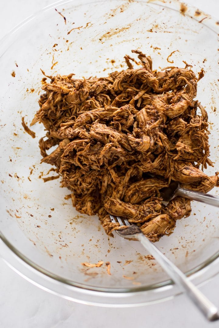 It's so easy to make shredded BBQ chicken in the Instant Pot, and it only takes 30 minutes in total. You will love this simple electric pressure cooker pulled chicken recipe. The sandwiches are amazing!