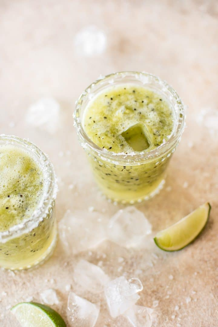 This refreshing blended kiwi margarita is a delicious easy summer drink recipe that's not too sweet.