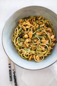 These low-carb Kung Pao zoodles are a healthy stir fry recipe that's ready in 15 minutes. You will love how the spicy sauce coats the zucchini noodles and peanuts in amazing flavor.