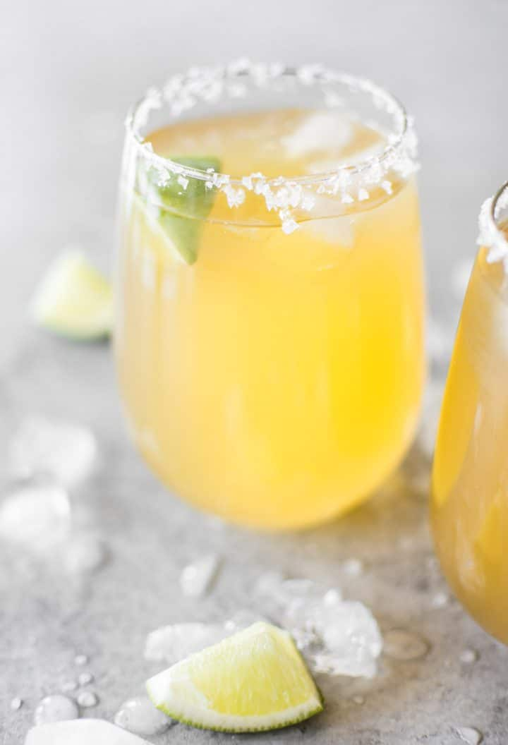 A fast and delicious passion fruit margarita recipe! The perfect easy drink for summer cocktails or Cinco de Mayo. Made with triple sec, tequila, fresh lime juice, and passion fruit juice.