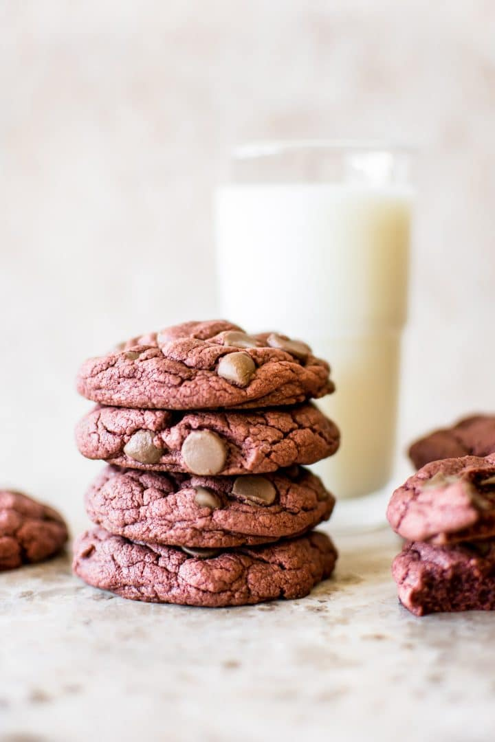 Soft, chewy, easy 3-ingredient (chocolate chips optional) red velvet cake mix cookies are quick and delicious. Perfect for Valentine's Day, Christmas, or any occasion. Duncan Hines boxed cake mix makes the best cookies!