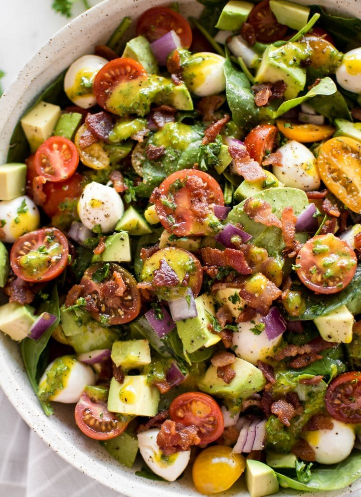 This easy avocado bacon salad with spinach, tomatoes, mozzarella, and a honey mustard vinaigrette dressing is perfect for healthy summer lunches. Quick and easy!