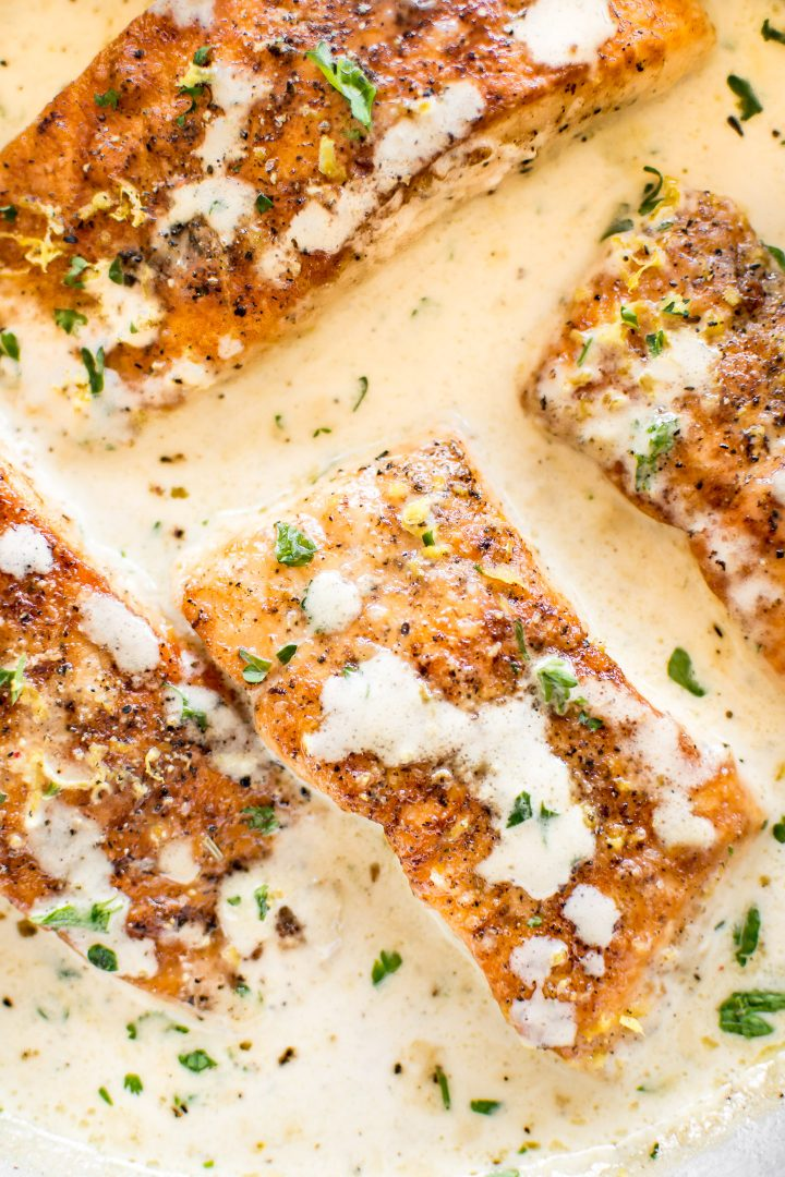 Tender pan-seared salmon in a creamy lemon garlic butter sauce is easy, quick, and sure to become a family favorite dinner!