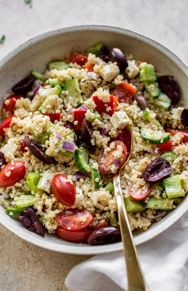 This healthy Greek quinoa salad is simple, easy to make, and delicious! The lemony vinaigrette dressing is light and flavorful. You can easily make the salad vegan by taking out the feta cheese.