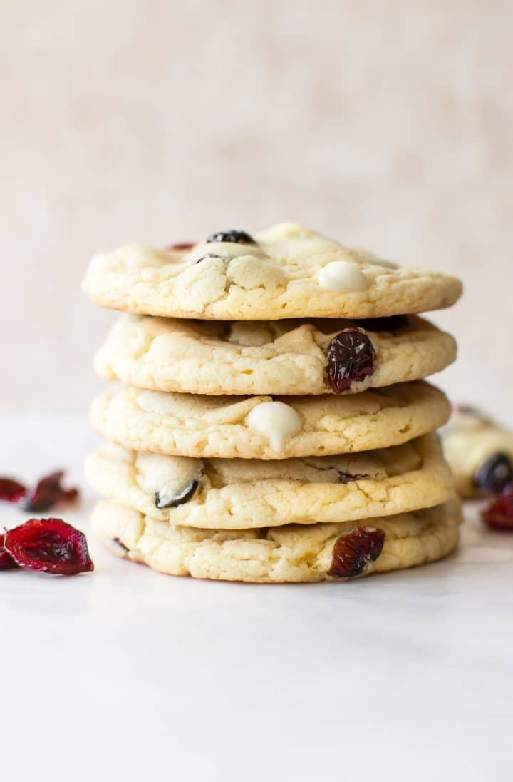 These easy white chocolate cranberry cookies are perfect for Christmas. Bake these for a holiday party or cookie exchange! They're made using yellow cake mix, so they're simple and take way less time than baking from scratch.