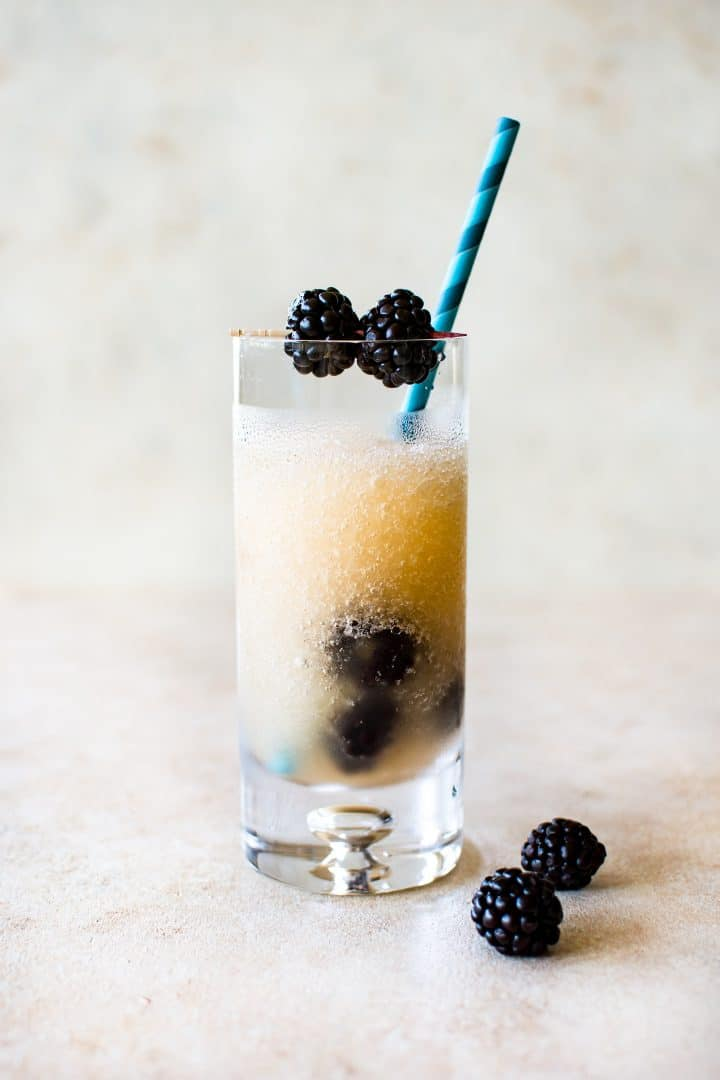 This frozen Riesling (Friesling) recipe is a tasty white wine slushy drink that will help you cool off all summer. It's infused with Chambord (a raspberry-blackberry liqueur) and fresh blackberries. Perfect for summer entertaining, parties, and girls' night!