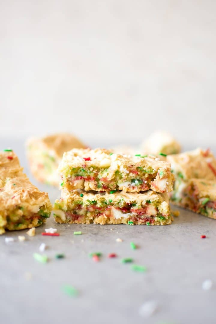 Easy Christmas cake batter blondies make holiday baking simpler! A perfect sweet treat that the whole family will love. You can bring these bars to Christmas parties or cookie exchanges, and kids will love them.