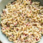 This classic macaroni salad is super easy to make! It's the best old fashioned creamy potluck salad. It has a vegetarian base that's perfect for adding extra protein if needed.