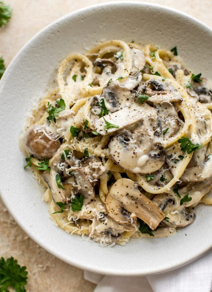 This creamy mushroom pasta recipe has plenty of garlic, white wine, butter, lemon juice, and cremini mushrooms. A delicious vegetarian entree that's perfect for dinner parties.