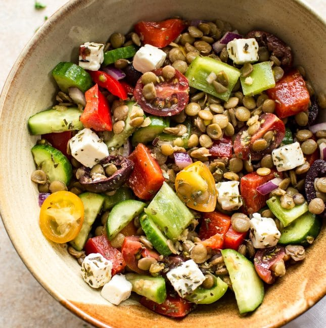 This Mediterranean lentil salad is easy and healthy! It's full of vegetables and plenty of feta. You'll love the tangy vinaigrette dressing. This salad is perfect for a summer lunch!