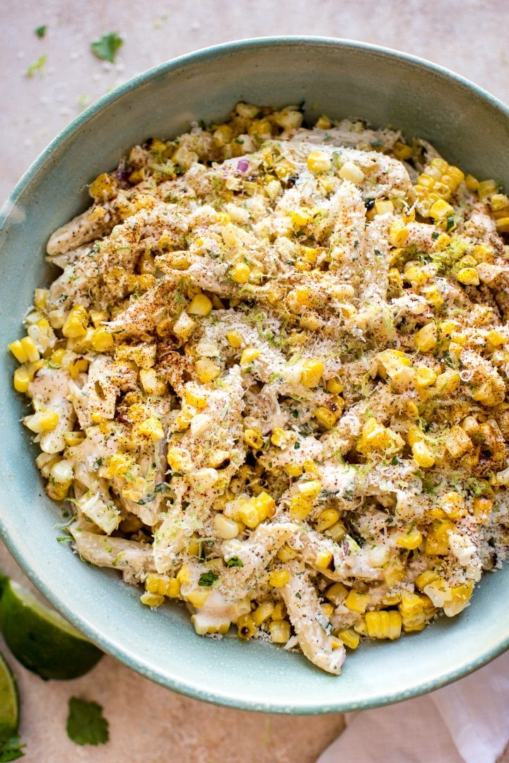 This easy Mexican street corn pasta salad is the perfect vegetarian grilled corn recipe to serve at summer BBQs, parties, or potlucks. The spicy chipotle lime dressing comes together fast, and eating the corn off the cob makes this authentic dish so much easier for a crowd to enjoy.