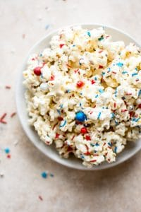 This patriotic marshmallow popcorn is the perfect snack of dessert to feed a crowd on the Fourth of July or Memorial Day! Kids and adults will love it. It's super easy to make.