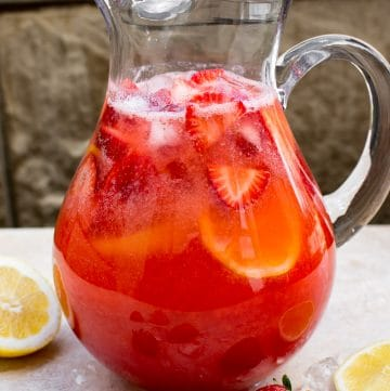 This easy homemade strawberry lemonade is made from fresh summer strawberries. It's a perfect mocktail as-is, but you can make it an alcoholic punch by adding vodka, moscato, or champagne. Or make it sparkling with club soda!