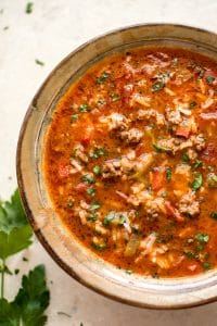 This is the best easy and healthy stuffed pepper soup recipe! It comes together fast and can be made either on the stovetop or in the Crockpot. A family favorite.