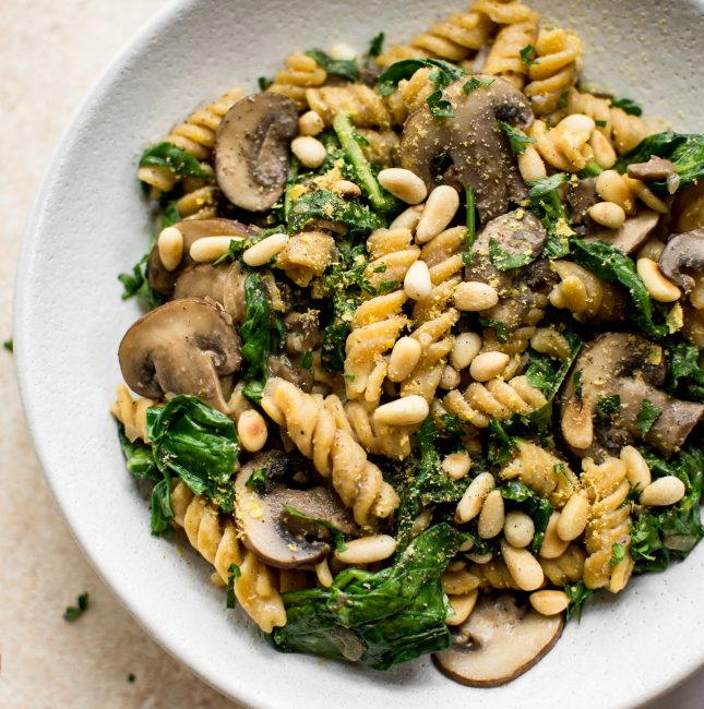 This healthy vegan spinach and mushroom pasta is quick and delicious comfort food dinner. Ready in about 20 minutes!