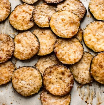 Easy baked parmesan zucchini chips with garlic and balsamic vinegar. A delicious roasted zucchini side dish. These little bites are a delicious low-carb keto snack!