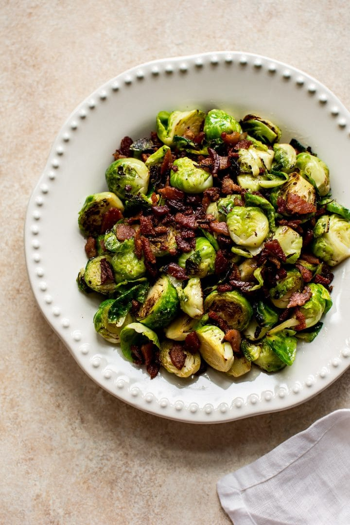 Brussels sprouts sautéed with bacon make an easy family-friendly side dish that even picky eaters will love. An awesome fall/winter keto recipe!