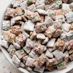 This Christmas puppy chow mix with powdered sugar, gluten-free rice Chex cereal, and plenty of sprinkles is a fun and family-friendly holiday party recipe! You won't be able to resist snacking on it.