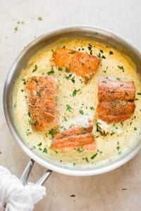 This salmon in a creamy Dijon mustard sauce is a simple comfort food dinner! This recipe can be made with either white wine or chicken broth.