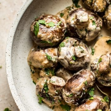 These creamy garlic mushrooms are seared until they're golden brown and then cooked in a mouthwatering cream sauce. A simple low-carb comfort food side dish that's ready in less than 20 minutes!