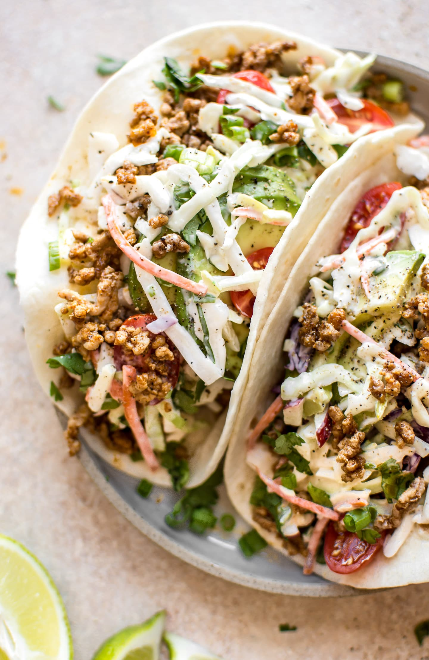 These ground pork tacos with apple slaw have a delicious seasoning mix that will make Taco Tuesday even better! The perfect easy dinner for meat lovers.