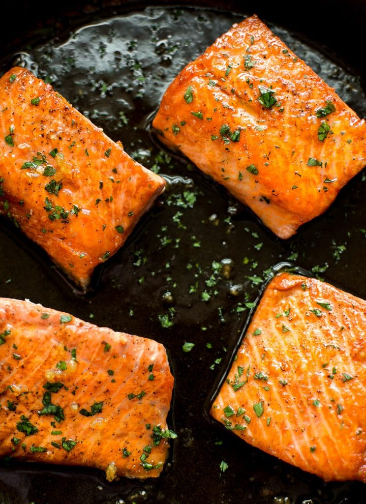 This easy honey garlic salmon recipe is made right in your skillet in less than 20 minutes. The salmon is pan-fried to perfection, and the honey glaze is totally delicious!