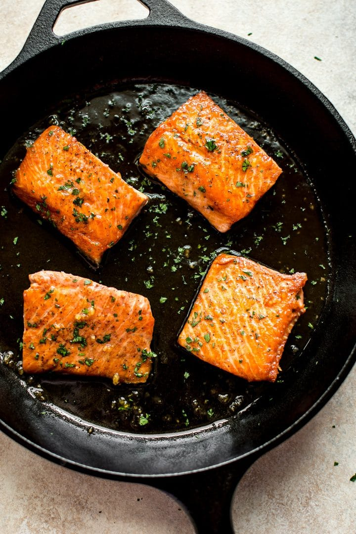 The perfect quick weeknight dinner recipe: pan-fried glazed honey garlic salmon.