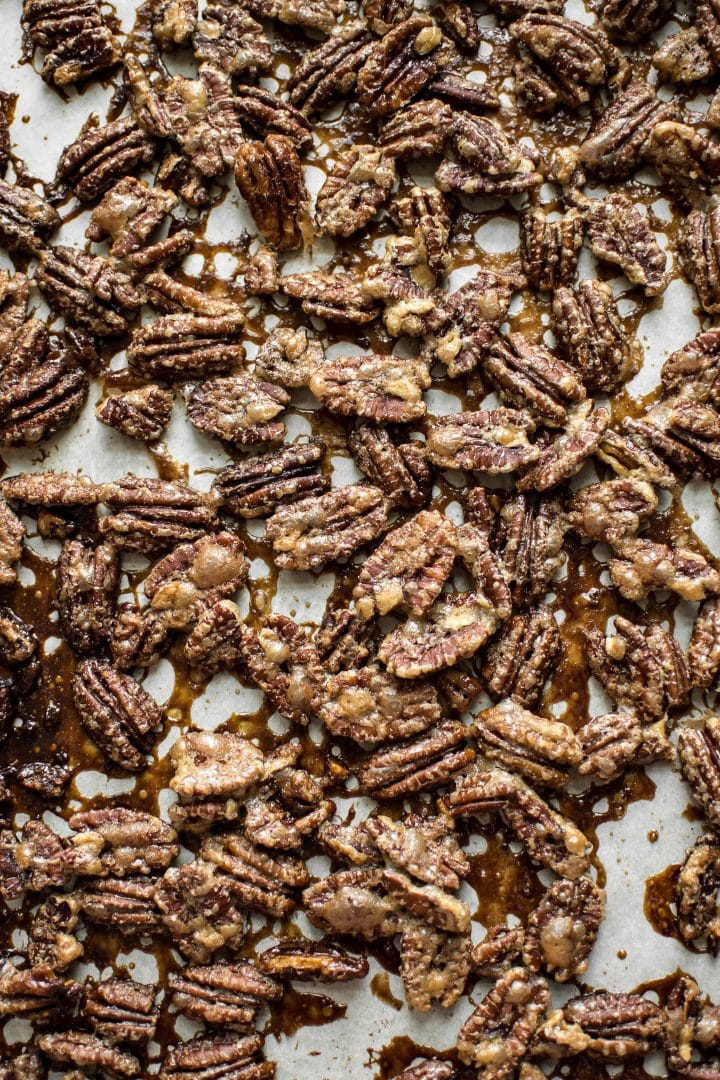 These maple roasted pecans are a delicious salad topping or snack! Perfect for Thanksgiving or the holidays.