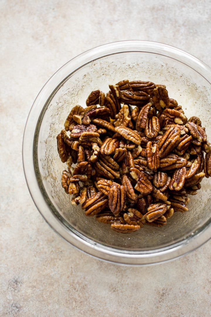 Maple roasted pecans in a bowl - the perfect holiday snack!