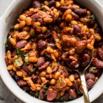 Easy homemade baked beans with bacon - a from scratch recipe that is perfect as a main course, side dish, or cookout/BBQ recipe.